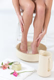Female feet in spa bowl with water Stock Image