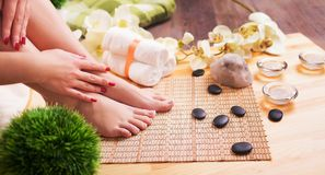 Female feet at spa pedicure procedure Stock Photo