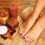 Female feet at spa salon on pedicure procedure Stock Photography