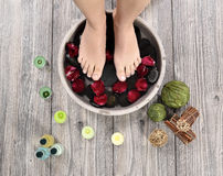 Female feet at spa salon on pedicure procedure Stock Image