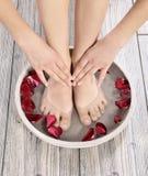 Female feet at spa salon on pedicure procedure Royalty Free Stock Image