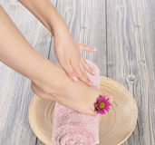 Female feet at spa salon on pedicure procedure Royalty Free Stock Photos