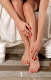 Female feet in spa salon,  pedicure procedure Stock Image