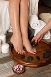 Female feet in spa salon,  pedicure procedure Royalty Free Stock Photo