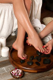 Female feet in spa salon,  pedicure procedure Stock Images