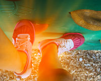 Female feet in sport shoes climbing on the climbing wall Stock Photo