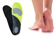 Feet and orthopedic insoles Royalty Free Stock Image