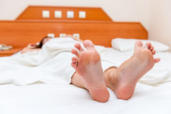 Female feet   stretch themselves upon waking Royalty Free Stock Image