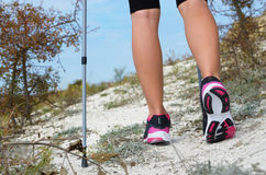 Female feet and trekking stick Royalty Free Stock Photo