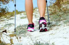 Female feet and trekking stick Stock Image