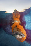 Female feet underwater stock photography