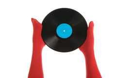 Female feet with vinyl record Stock Photography