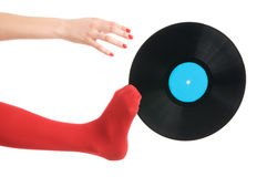 Female feet with vinyl record Royalty Free Stock Photo