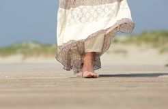 Female feet walking forward at the beach Royalty Free Stock Photo