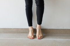Female feet wearing slippers or flip-flop outdoor red nail Royalty Free Stock Photo