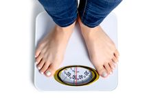 Female feet weighing scale royalty free stock image