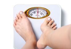 Female feet weighing scale royalty free stock images