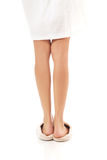 Female feet in white slippers Royalty Free Stock Photography