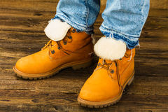 Female feet in winter boots and jeans Royalty Free Stock Photo