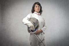 Female fencer. Portrait of a young female fencer royalty free stock photography