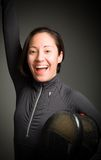 Female fencer celebrating with her arms raised Royalty Free Stock Image
