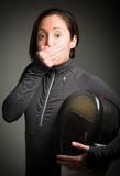 Female fencer hand over her mouth and shock Stock Photos
