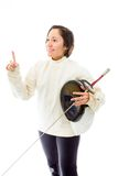 Female fencer holding a mask and sword with pointing upward Stock Photo