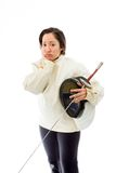 Female fencer looking sad with a holding mask and sword Stock Photos