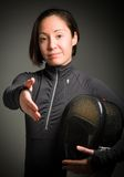 Female fencer offering hand for handshake Stock Photo