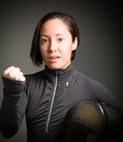 Female fencer punching the air Royalty Free Stock Photo