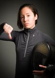 Female fencer showing thumbs down sign Stock Photography