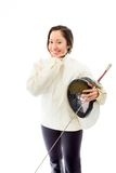 Female fencer smiling with her hand on chin Royalty Free Stock Photos
