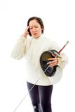 Female fencer suffering from headache Stock Image