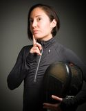 Female fencer thinking with hand on chin Stock Image