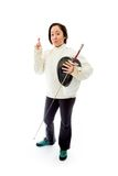 Female fencer wishing with crossing fingers with a Royalty Free Stock Photo