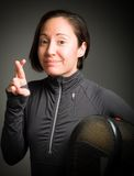 Female fencer wishing with crossing fingers Stock Image