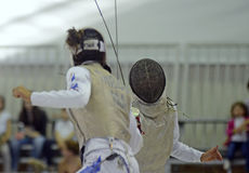 Female Fencing Attack Royalty Free Stock Images
