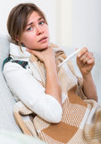 Female with fever at home Stock Image