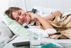 Female with fever at home Stock Photography