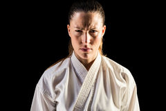 Female fighter on black background stock photos