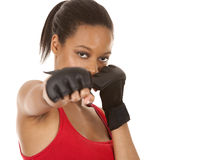 Female fighter. Black fitness model wearing red fitness outfit on white background Royalty Free Stock Photo