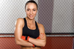 Female fighter in a cage Stock Photos