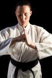 Female fighter performing hand salute Royalty Free Stock Image