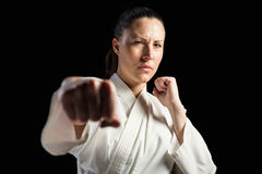 Female fighter performing karate stance Stock Photography