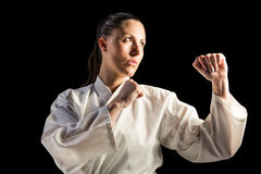 Female fighter performing karate stance Royalty Free Stock Image