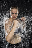 Female Fighter in Water Splashes Looking Fierce stock images