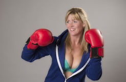 Female fighter wearing red boxing gloves Royalty Free Stock Photos