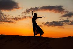 Female figure against the sky. Royalty Free Stock Photography