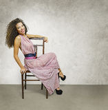 A female figure on a chair Royalty Free Stock Photo