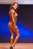 Female figure model shows her best at championship on stage Royalty Free Stock Image